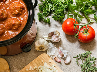 "It's five o'clock and you're finally on your way home when the inevitable question arises, ""What's for dinner?"" The solution may be no further than the slow cooker on your kitchen counter."