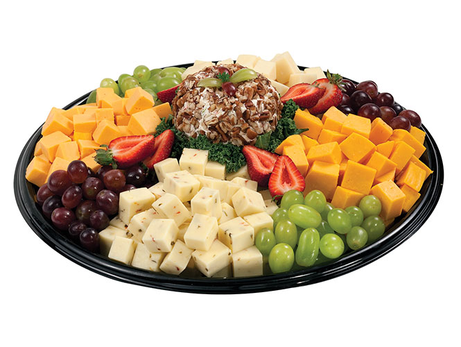 The Food City Cheese Taster deli platter features hot pepper, Colby, Baby Swiss and yellow American surrounding a creamy cheese ball and garnished with strawberries and red and white grapes.